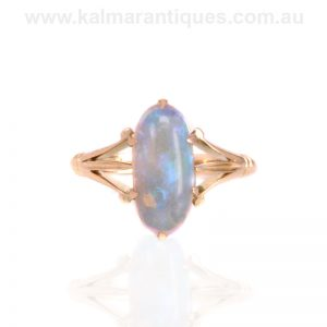 Antique solid opal ring set in 15 carat gold made in the early 1900's