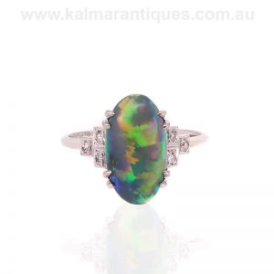 Art Deco era solid Lightning Ridge black opal and diamond ring