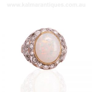 Art Deco opal and diamond ring handmade in platinum and gold.