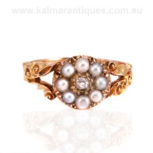 18 carat antique pearl and diamond cluster ring made in the 1870's