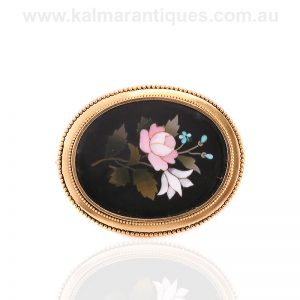 Antique pietra dura brooch with a locket on the reverse side