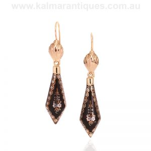 Antique pique drop earrings set on 18 carat gold tops