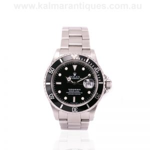 Rolex Submariner 16610 with full box, papers and Rolex service history