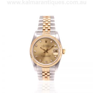 Mid-size gold and steel Rolex 68273 with the diamond dial