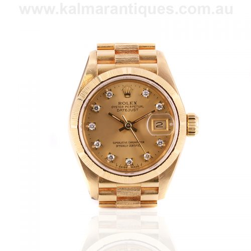 Ladies 18ct gold Rolex diamond dial President bark finish watch