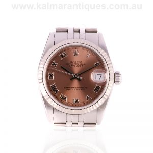 Mid-size Rolex watch reference 68274 with the salmon coloured dial