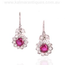 Exquisite platinum ruby and diamond cluster drop earrings