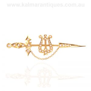Antique sword and seed pearl brooch made by Willis in 15 carat gold