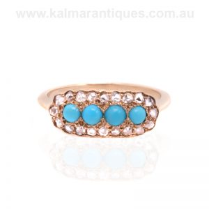 Antique turquoise ring surrounded by rose cut diamonds