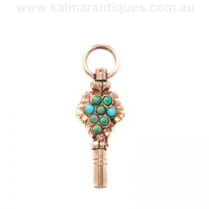 Antique pocket watch key set with turquoise
