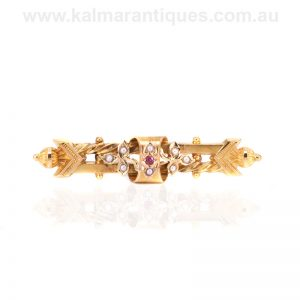 15 carat gold antique ruby and pearl brooch by Willis