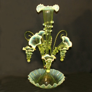 Glass epergne with hanging baskets.