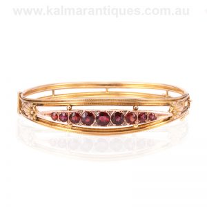 Antique garnet bangle set with rose cut diamonds in between