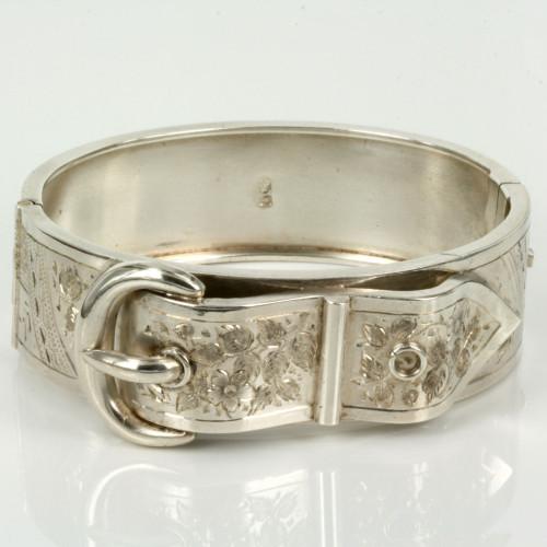 Antique sterling silver bangle in a buckle design.