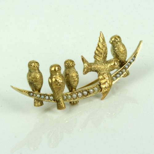 Antique pearl set bird brooch.