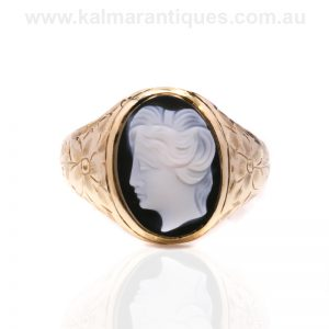 Antique hardstone onyx cameo ring with hand engraved shoulders