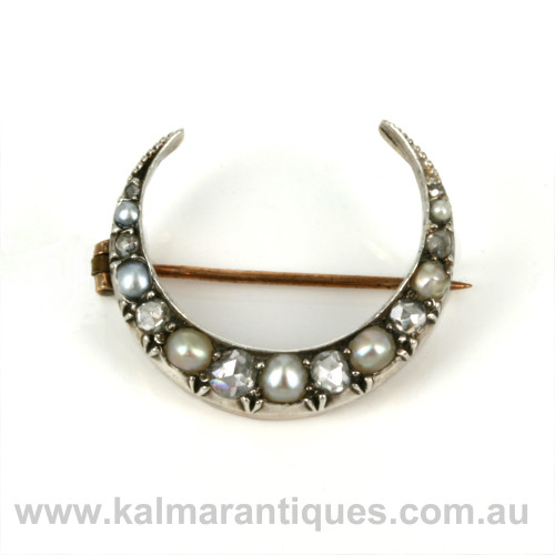 Antique diamond and pearl crescent brooch