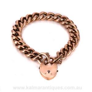 Antique rose gold curb link padlock bracelet