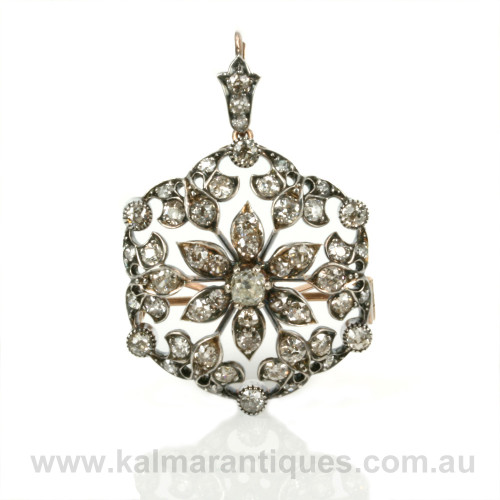 Antique diamond pendant that converts to a brooch