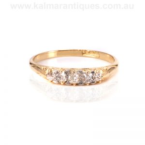 Antique diamond engagement ring set with mine cut diamonds