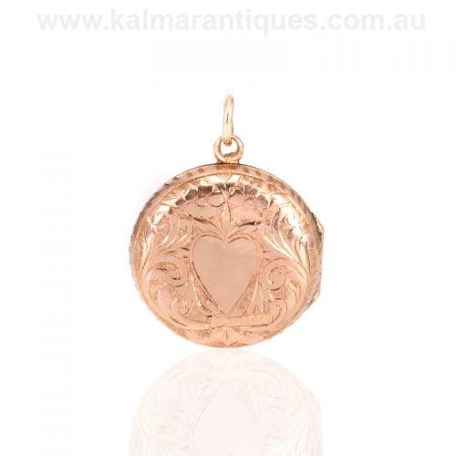 Antique rose gold round engraved locket made in 1906