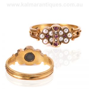 Antique ruby, pearl and diamond ring with a secret locket