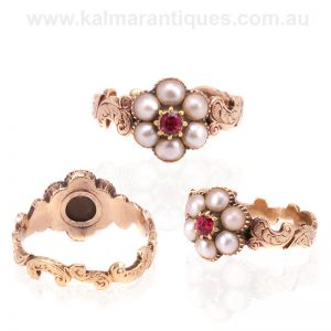 18 carat antique ruby and pearl ring with a secret locket