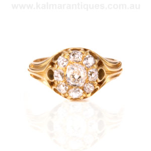 Antique diamond cluster engagement ring set with mine cut diamonds