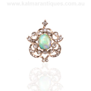 Antique opal and diamond pendant that converts to a brooch