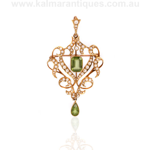 Antique peridot and pearl pendant that converts to a brooch