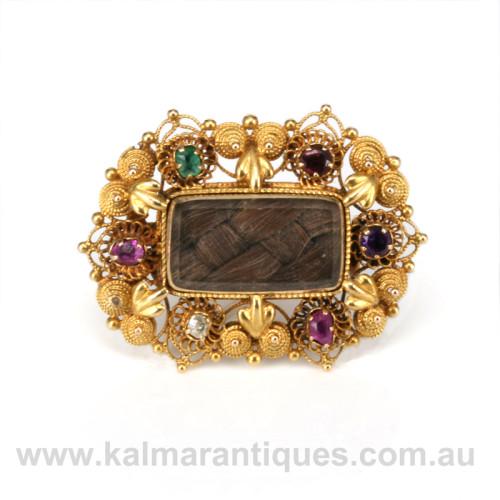 Antique regard brooch
