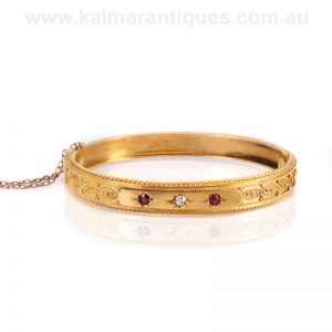 Antique 15ct yellow gold ruby and diamond bangle