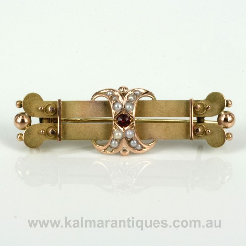 Antique ruby and pearl brooch made in 1899