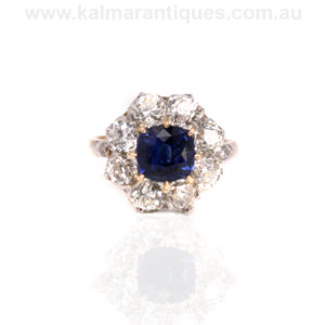 Antique sapphire and diamond cluster engagement ring. Princess Di engagement ring