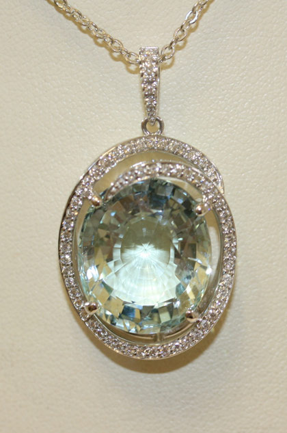 18ct Aquamarine and diamond pendant.