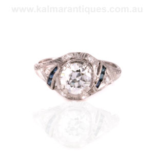 Art Deco diamond engagement ring with side sapphires