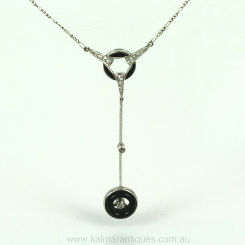 Art Deco onyx and diamond platinum pendant