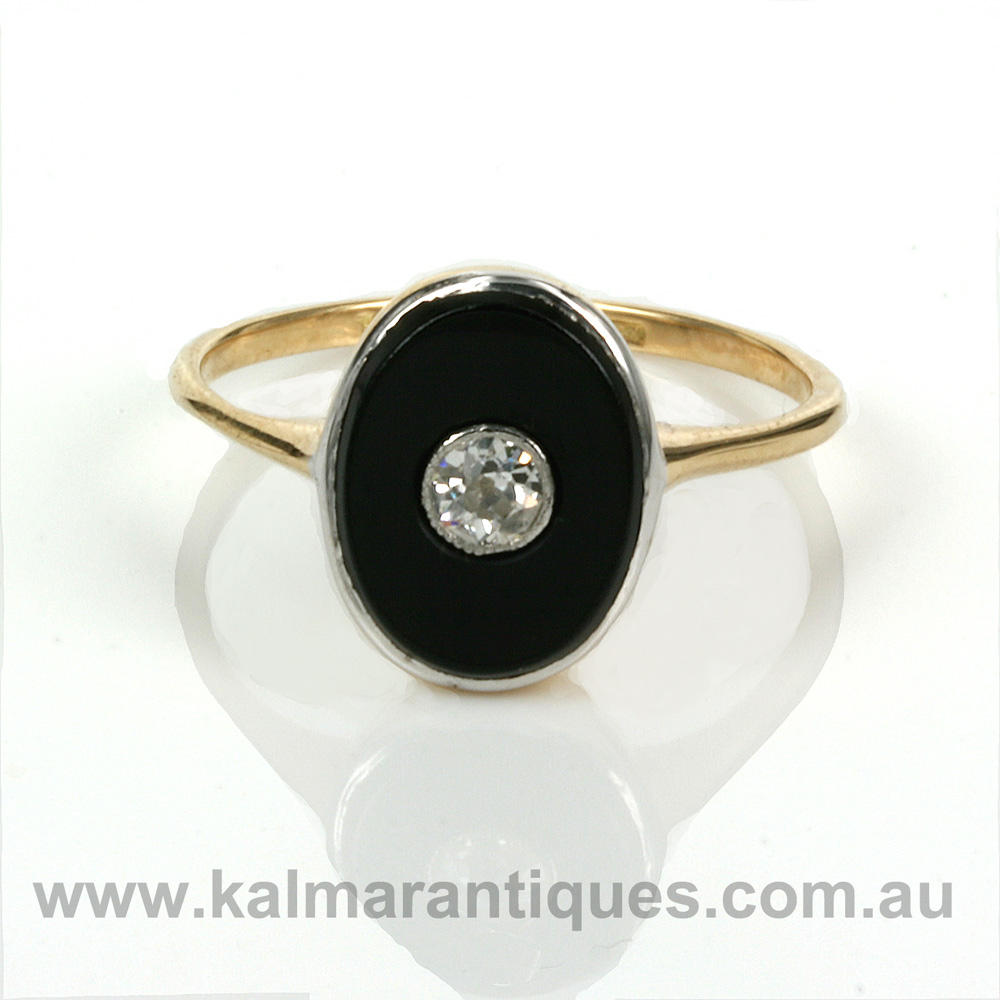 Platinum And Gold Art Deco Onyx And Diamond Ring