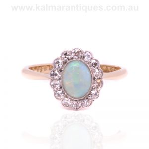 18ct gold and platinum Art Deco opal ring surrounded by diamonds