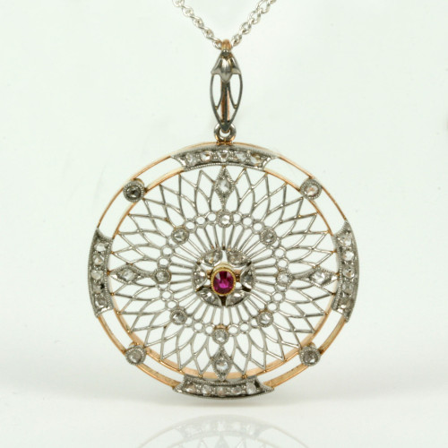 Art Deco ruby and diamond pendant in gold and platinum.