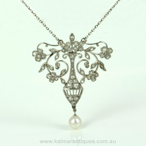 Platinum diamond and pearl pendant by Elkington and Co