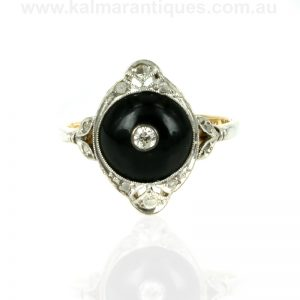 Platinum and gold Art Deco diamond & onyx ring with 11 diamonds