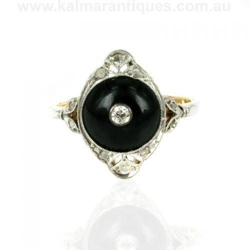 Platinum and gold Art Deco diamond & onyx ring with 11 diamonds