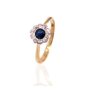 Art Deco sapphire and diamond cluster engagement ring