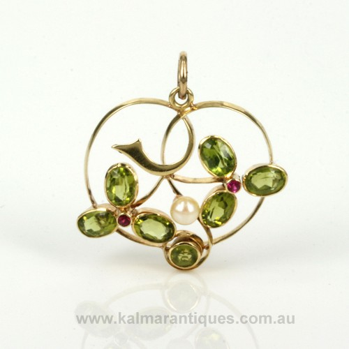 Art Nouveau peridot, pearl and ruby pendant