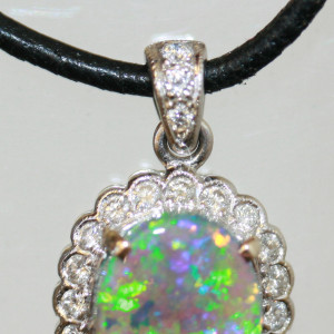Solid black opal and diamond pendant.