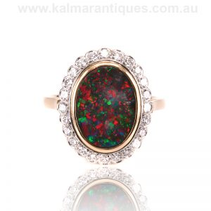 16 carat gold and platinum Lightning Ridge black opal and diamond ring