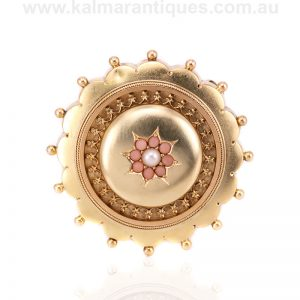 Antique coral and pearl brooch with a locket section