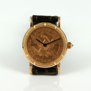 Gold coin Corum watch with the diamond crown.