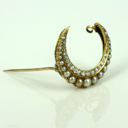 Antique diamond and pearl crescent brooch.